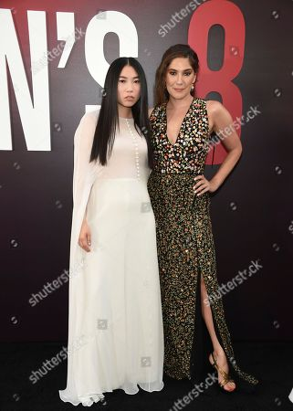 """Awkwafina, Olivia Milch. Actress Awkwafina, left, and screenwriter Olivia Milch attend the world premiere of """"Ocean's 8"""" at Alice Tully Hall, in New York"""
