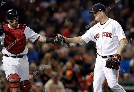 Steven Wright, Christian Vazquez. Boston Red Sox starting pitcher Steven Wright, right, is congratulated by catcher Christian Vazquez after fielding a grounder by Detroit Tigers' Dixon Machado, who was out to end the top of fifth inning of a baseball game at Fenway Park in Boston