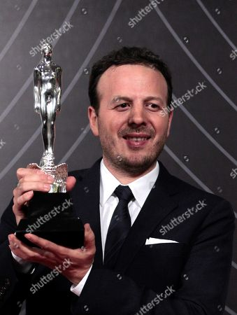 Stock Picture of Mexican film director Amat Escalante poses with his Arial Award to the Best Director for 'The Untamed' during Mexico's 60th Ariel Film Awards handover ceremony held in Mexico City, Mexico, 05 June 2018 (issued on 06 June).