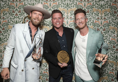 Trail Blazer Award Winners Florida Georgia Line's Brian Kelley and Tyler Hubbard (left) and pose with Executive of the Year Winner Jason Owen