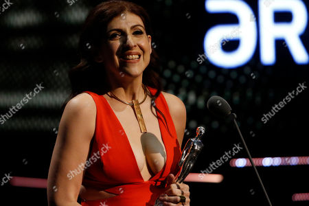 """Mexican actress Karina Gidi accepts her Ariel award for best supporting actor in """"Loa adioses"""" during the Mexican Ariel Film Academy Awards at the Bellas Artes Palace in Mexico City, Mexico, . The Ariel awards recognize excellence in motion picture making, such as acting, directing and screen writing in Mexican cinema"""