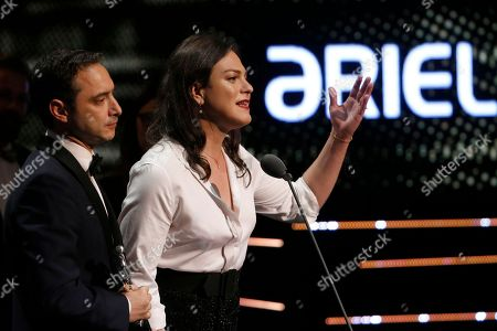 "Stock Photo of Daniela Vega, Juan de Dios Larrain. Chilean actress Daniela Vega and the producer Juan de Dios Larrain accept the award for best Ibero-American film for ""Una mujer fantástica"" at the Mexican Ariel Film Academy Awards ceremony at the Bellas Artes Palace in Mexico City, . The Ariel Awards recognize excellence in motion picture making, such as acting, directing and screen writing in Mexican cinema"