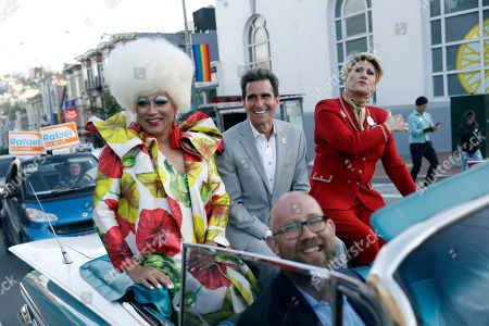 San Francisco mayoral candidate Mark Leno, center, is driven around the Castro District, in San Francisco