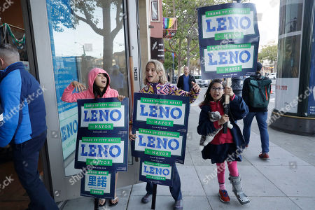 Supporters of San Francisco mayoral candidate Mark Leno hold signs in the Castro District, in San Francisco