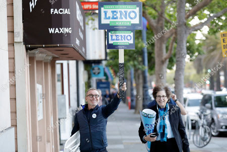 Supporters of San Francisco mayoral candidate Mark Leno walk with signs in the Castro District, in San Francisco