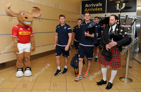 (L to R) Mark Bennett and Mark Robertson walk through the arrivals doors at Edmonton airport. Scotland rugby union players and coaches arrive