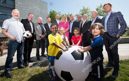 Pictured today (Back Row L-R) Stephen Alkin, Ronnie Whelan, Eamon Dunphy, Darragh Maloney, Richie Sadlier, Jacqui Hurley, Didi Hamann, Peter Collins, Ger Canning, John Kenny, Adrian Eames and Damien Duff. (Front Row L-R) Ayana O Callaghan (aged 8 from Clontarf - Brazil), Carly Kane (aged 6 from Swords - Germany), Jake Farmer (aged 7 from Castleknock - Portugal) and Luke Freeman (aged 6 from Artane -France)