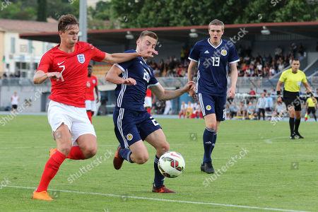 Kieran Dowell of England U21's takes the ball past Scotland U21's Alan Campbell during Scotland Under-21 vs England Under-21, Tournoi Maurice Revello Football at Stade de Lattre-de-Tassigny on 6th June 2018