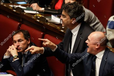Democratic Party lawmaker Emanuele Fiano, second from right, argues with Italian premier Giuseppe Conte at the Lower House, ahead of a confidence vote on the government program, in Rome, . Conte is addressing the Lower House for a confidence vote on his government programme after winning the confidence vote at the Senate Tuesday night
