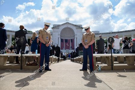 US marines bow their heads as the audience observes a prayer during the Robert Francis Kennedy memorial service at Arlington National Cemetery Memorial Amphitheater, in Arlington, Virginia, USA, 06 June 2018. The event was held to honor the life and legacy of Robert F. Kennedy, who was assassinated in Los Angeles, dying in the early hours of 06 June, 1968.