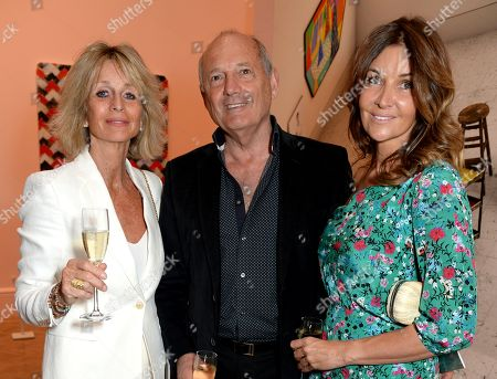 Stock Photo of Ron Dennis (middle) with guests