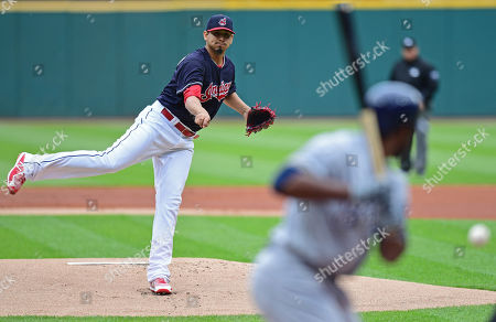 Stock Picture of Cleveland Indians starting pitcher Carlos Carrasco delivers to Milwaukee Brewers' Jonathan Cain in the first inning of a baseball game, in Cleveland