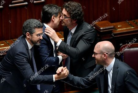 Italian Prime Minister Giuseppe Conte (2L) with the ministers Riccardo Fraccaro (L), Danilo Toninelli (2R) and Lorenzo Fontana (R) celebrate after the vote of confidence to the new Government in the Chamber of Montecitorio, Rome, Italy 06 June 2018.