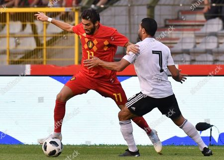 Belgium's Yannick Carrasco, left, is challenged by Egypt's Ahmed Fathy during a friendly soccer match between Belgium and Egypt at the King Baudouin stadium in Brussels