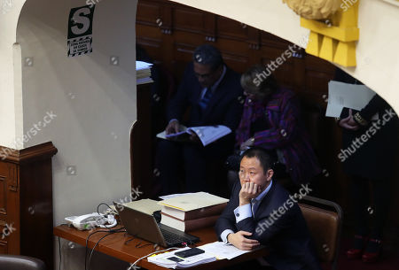 Parliamentarian Kenji Fujimori attends to a session in Congress, in Lima, Peru, 06 June 2018. The plenary session of the Congress debates whether to dismiss parliamentarians Kenji Fujimori, Bienvenido Ramírez and Guillermo Bocangel for allegedly trying to buy votes to save former President Pedro Pablo Kuczynski from impeachment.