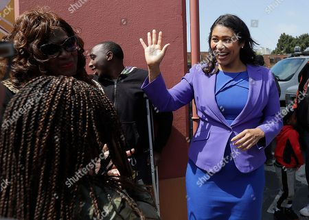 Board of Supervisors President London Breed, right, greets supporters after speaking to reporters in San Francisco, . Former state Sen. Mark Leno pulled ahead in San Francisco's race for mayor by the slimmest of margins early Wednesday under the city's unusual voting system, although Breed maintained her lead in first-place votes