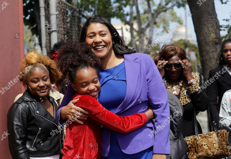 Board of Supervisors President London Breed, center, greets supporters before speaking to reporters in San Francisco, . Former state Sen. Mark Leno pulled ahead in San Francisco's race for mayor by the slimmest of margins early Wednesday under the city's unusual voting system, although Breed maintained her lead in first-place votes