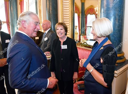 Prince Charles with Dame Penelope Wilton and Kate Adie during a reception for Age UK at Buckingham Palace