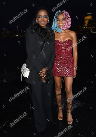 Stock Image of Lauryn Hill, Selah Marley. Singer Lauryn Hill, left, and daughter Selah Marley attend the Saint Laurent Spring/Summer 2019 Menswear Collection at Liberty State Park, in Jersey City, N.J