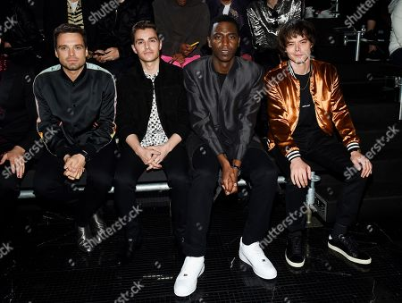 Sebastian Stan, Dave Franco, Jerrod Carmichael, Charlie Heaton. Actors Sebastian Stan, Dave Franco, Jerrod Carmichael and Charlie Heaton, from left, attend the Saint Laurent Spring/Summer 2019 Menswear Collection at Liberty State Park, in Jersey City, N.J