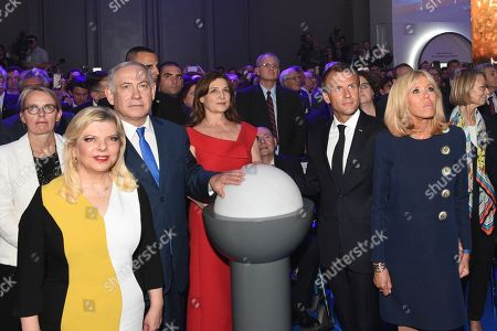 """Stock Photo of French President Emmanuel Macron, his wife Brigitte Trogneux with Israeli Prime Minister Benjamin Netanyahu and his wife Sara Ben-Artzi, Aliza Bin Noun attending the unveiling ceremony at the Grand Palais of the exhibition """"Israel@Lights"""""""