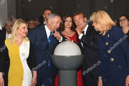 """Stock Image of French President Emmanuel Macron, his wife Brigitte Trogneux with Israeli Prime Minister Benjamin Netanyahu and his wife Sara Ben-Artzi, Aliza Bin Noun attending the unveiling ceremony at the Grand Palais of the exhibition """"Israel@Lights"""""""