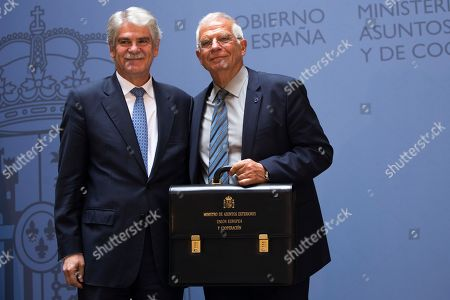 Stock Photo of Josep Borrell, Alfonso Dastis. New Foreign Minister Josep Borrell, right, receives a briefcase from outgoing Minister Alfonso Dastis during the handing over of the ministerial responsibilities at the Foreign Ministry in Madrid, . The government cabinet with the highest proportion of female ministers in Spanish and European history was sworn in Thursday, putting the cap on one of the fastest power transitions in Spain's four decades of democratic rule