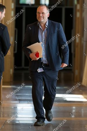 Stock Image of Scottish Parliament First Minister's Questions - Andy Wightman makes his way to the Debating Chamber