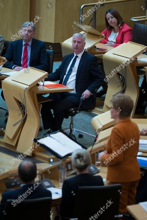 Scottish Parliament First Minister's Questions - Richard Leonard, Leader of the Scottish Labour Party, James Kelly and Kezia Dugdale listen to Nicola Sturgeon, First Minister of Scotland and Leader of the Scottish National Party (SNP)