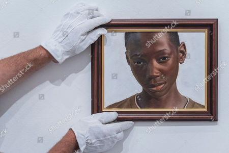 Stock Picture of 'A Portrait of Gifty from Shitima' by Huey Glynn-Jones is a portrait of a young boy the artist met while volunteering at a school in Zambia.