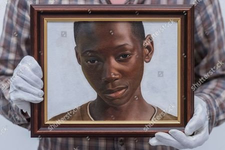 'A Portrait of Gifty from Shitima' by Huey Glynn-Jones is a portrait of a young boy the artist met while volunteering at a school in Zambia.