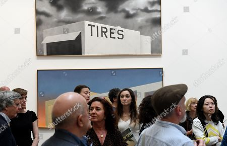 """Visitors look at a painting entitled """"Blue Collar Tires) during the exhibition """"Ed Ruscha: Course of Empire"""" in the National Gallery in London, Britain, 07 June 2018. The exhibition will open to the public from 11 June until the 07 October 2018."""