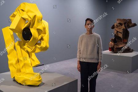 Artist Carol Bove poses next to her work titled Nike II, 2018 (L) and Nike I 2018 (R)