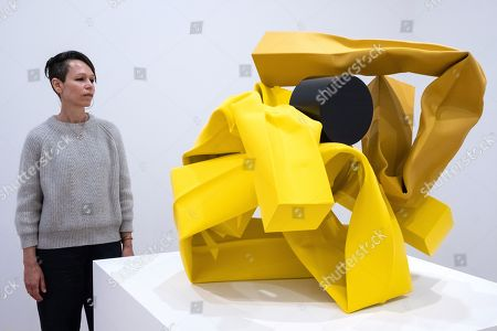 Artist Carol Bove poses next to her work titled  Cutting Corners, 2018
