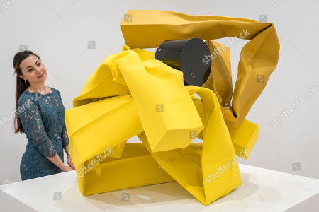 """A staff member views """"Cutting Corners"""", 2018, by Carol Bove at the preview of an exhibition of steel sculptures by the American artist at the David Zwirner gallery"""