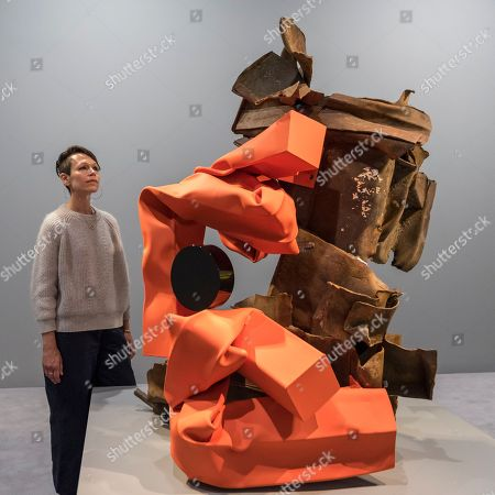 """American artist Carol Bove poses with """"Turtle"""", 2018, at the preview of an exhibition of her steel sculptures at the David Zwirner gallery"""