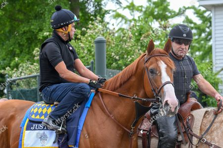 Justify out on the track in preparation for the Belmont Stakes with assistant Trainer Jimmy Barnes, 06/07/2018, Belmont Race Track, Elmont, NY, USA