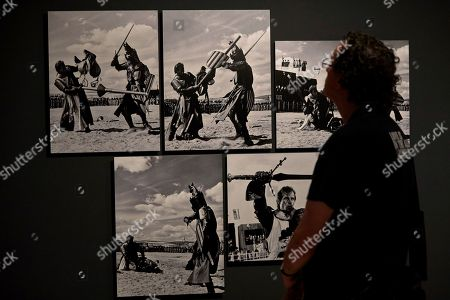 Stock Picture of A man looks at photographs on display in the exhibition 'Cerca de Hollywood' (lit.: Near Hollywood) in Barcelona, Spain, 07 June 2018. The exhibition presents the work of the Spanish photographers and brothers Claudi and Frederic Gomez Grau and features photographs from the filming of American blockbusters in Spain and actors like Charlton Heston, Sophia Loren, Georges C. Scott or Richard Harris.