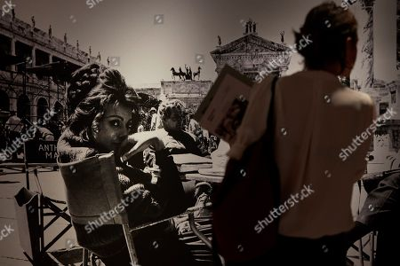 A woman looks at a photograph on display in the exhibition 'Cerca de Hollywood' (lit.: Near Hollywood) in Barcelona, Spain, 07 June 2018. The exhibition presents the work of the Spanish photographers and brothers Claudi and Frederic Gomez Grau and features photographs from the filming of American blockbusters in Spain and actors like Charlton Heston, Sophia Loren, Georges C. Scott or Richard Harris.