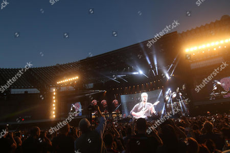 People attend a concert-event in tribute to late Italian singer-songwriter Pino Daniele at the San Paolo stadium in Naples, Italy, 07 June 2018.
