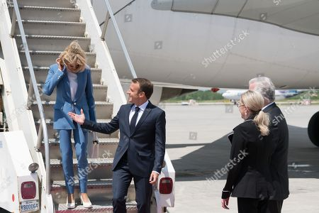 Brigitte and Emmanuel Macron, Philippe Couillard and his wife.