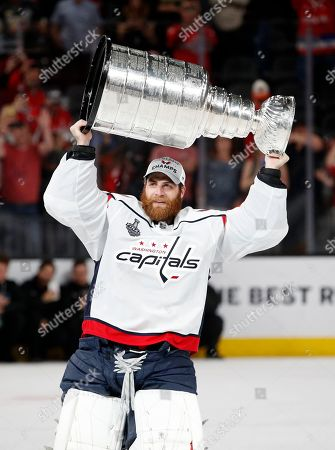 f9bbb5d828e Washington Capitals goaltender Braden Holtby hoists the Stanley Cup after the  Capitals defeated the Golden Knights ...