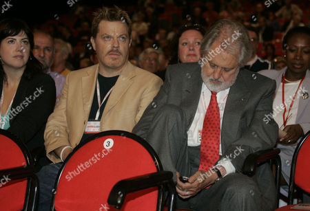 Comedian Eddie Izzard Listens To David Blunkett Speaking To The Labour Party Conference As Film Producer Lord (david ) Putnam Conducts A Text Message Conversation.
