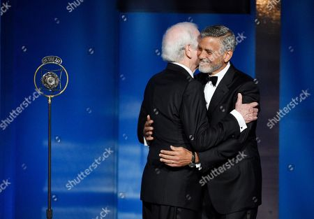 George Clooney, Nick Clooney. Actor/director George Clooney, right, gets a hug from his father Nick as he is introduced onstage at the 46th AFI Life Achievement Award honoring him at the Dolby Theatre, in Los Angeles
