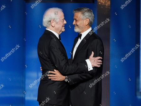 George Clooney, Nick Clooney. Actor/director George Clooney, right, is greeted by his father Nick as he is introduced onstage at the 46th AFI Life Achievement Award honoring him at the Dolby Theatre, in Los Angeles