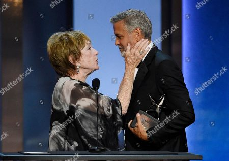 Shirley Maclaine, George Clooney. Actor George Clooney, right, accepts the 46th AFI Life Achievement Award from actress Shirley MacLaine during a gala ceremony at the Dolby Theatre, in Los Angeles