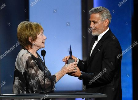 Shirley Maclaine, George Clooney. Actor/director George Clooney, right, accepts the 46th AFI Life Achievement Award from actress Shirley MacLaine during a gala ceremony at the Dolby Theatre, in Los Angeles