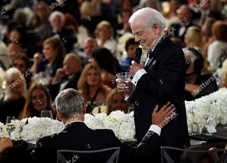 George Clooney, Nick Clooney. Nick Clooney, right, toasts his son, actor/director George Clooney, during the 46th AFI Life Achievement Award gala ceremony honoring George Clooney at the Dolby Theatre, in Los Angeles