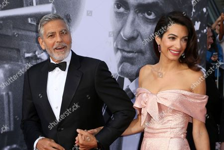 George Clooney, Amal Clooney. George Clooney, left, and Amal Clooney arrive at the 46th AFI Life Achievement Award Honoring George Clooney at the Dolby Theatre, in Los Angeles