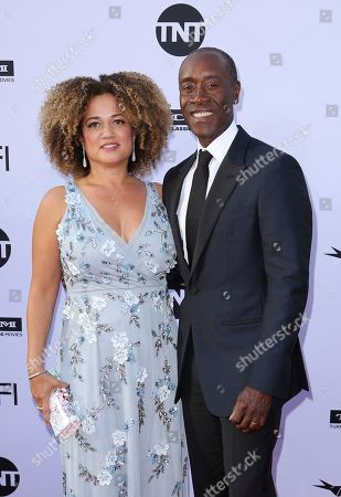 Bridgid Coulter, Don Cheadle. Bridgid Coulter, left, and Don Cheadle arrive at the 46th AFI Life Achievement Award Honoring George Clooney at the Dolby Theatre, in Los Angeles